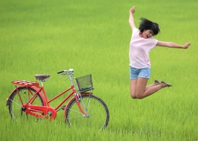 girl playing with bicycle